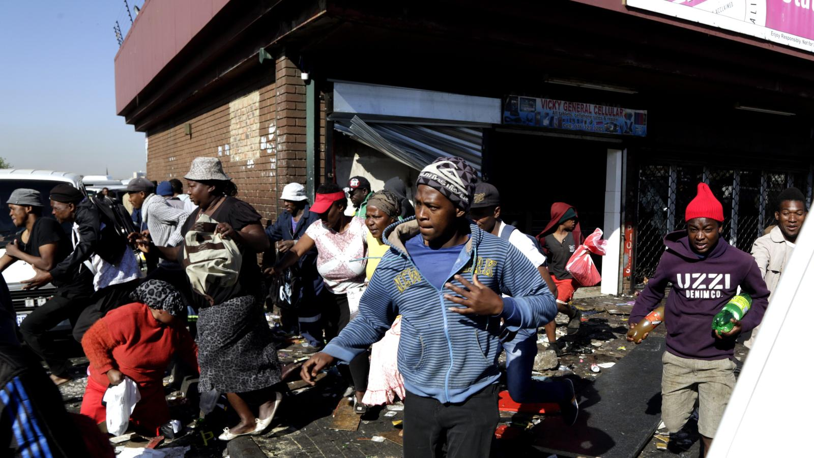 Looters make off with goods from a store in Germiston, east of Johannesburg, South Africa as part of the xenophobic violence against African store owners