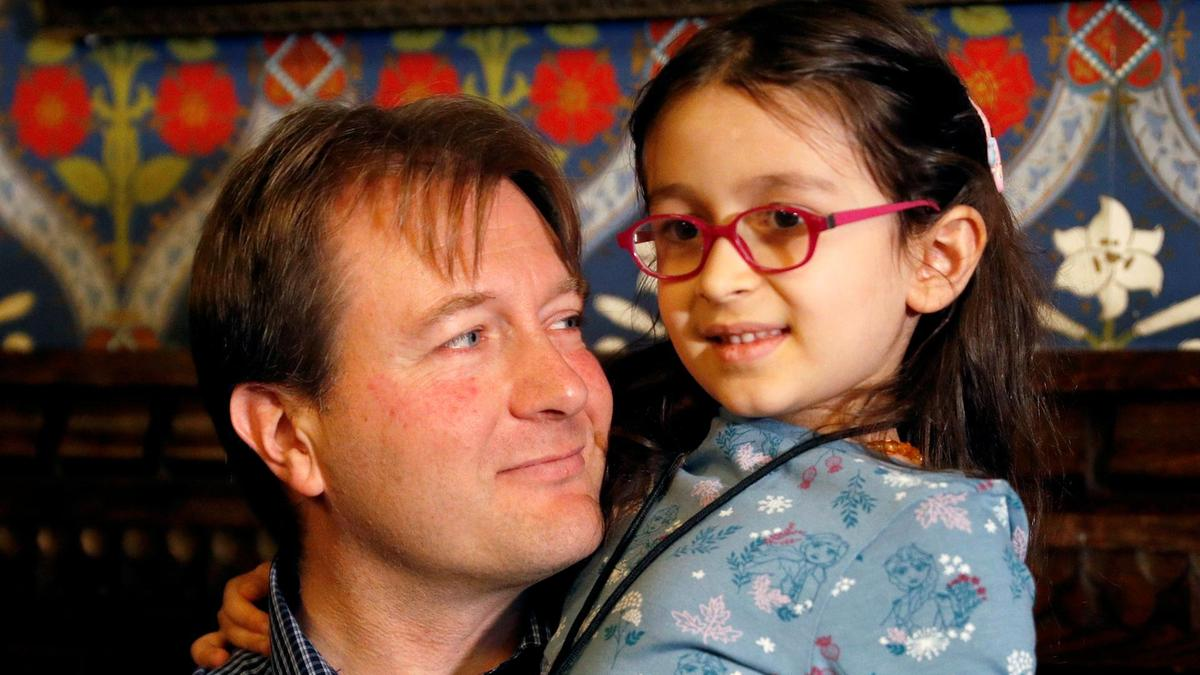 Richard Ratcliffe, the husband of jailed British-Iranian aid worker Nazanin Zaghari-Ratcliffe, sits with his daughter Gabriella during a press conference in London. Reuters