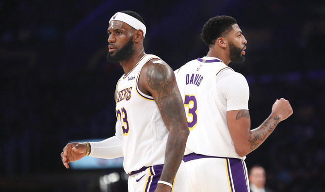 LeBron James, left, and Anthony Davis of the Los Angeles Lakers look on during a game in Los Angeles. (AFP)