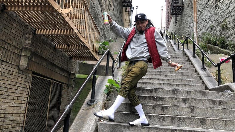 "Jay Garcia, a radio host from Queens, dances down the ""Joker Steps"" in the Bronx. (Reuters)"
