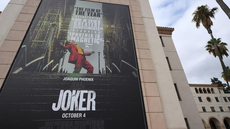 "A poster for the film ""The Joker"" is seen outside Warner Brothers Studios in Burbank, California. (Reuters)"