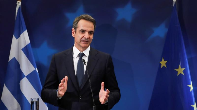 Mitsotakis says he wants Greece and Turkey to discuss differences about maritime zones in the Aegean and the eastern Mediterranean on a political and diplomatic level [File: Yves Herman/Reuters]