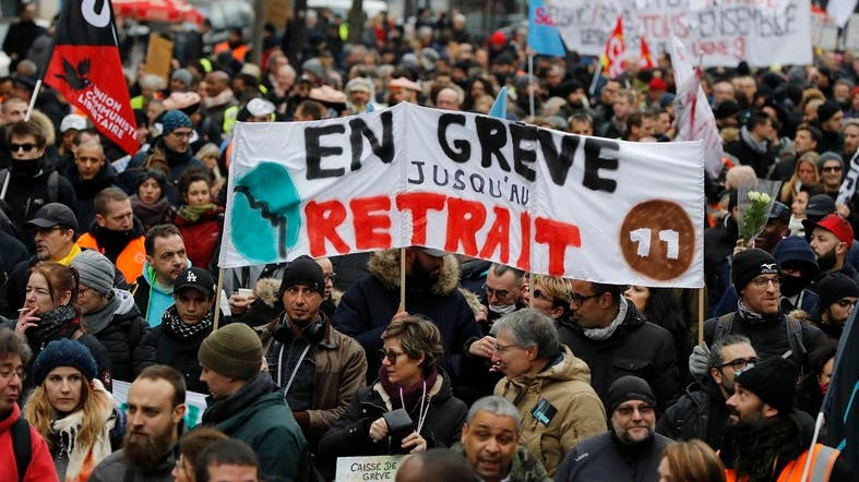 "A banner reading ""On strike untill withdrawal"" during a demonstration called by French national trade union General Confederation of Labour against the pension reform on January 4, 2020, in Paris. (AFP)"