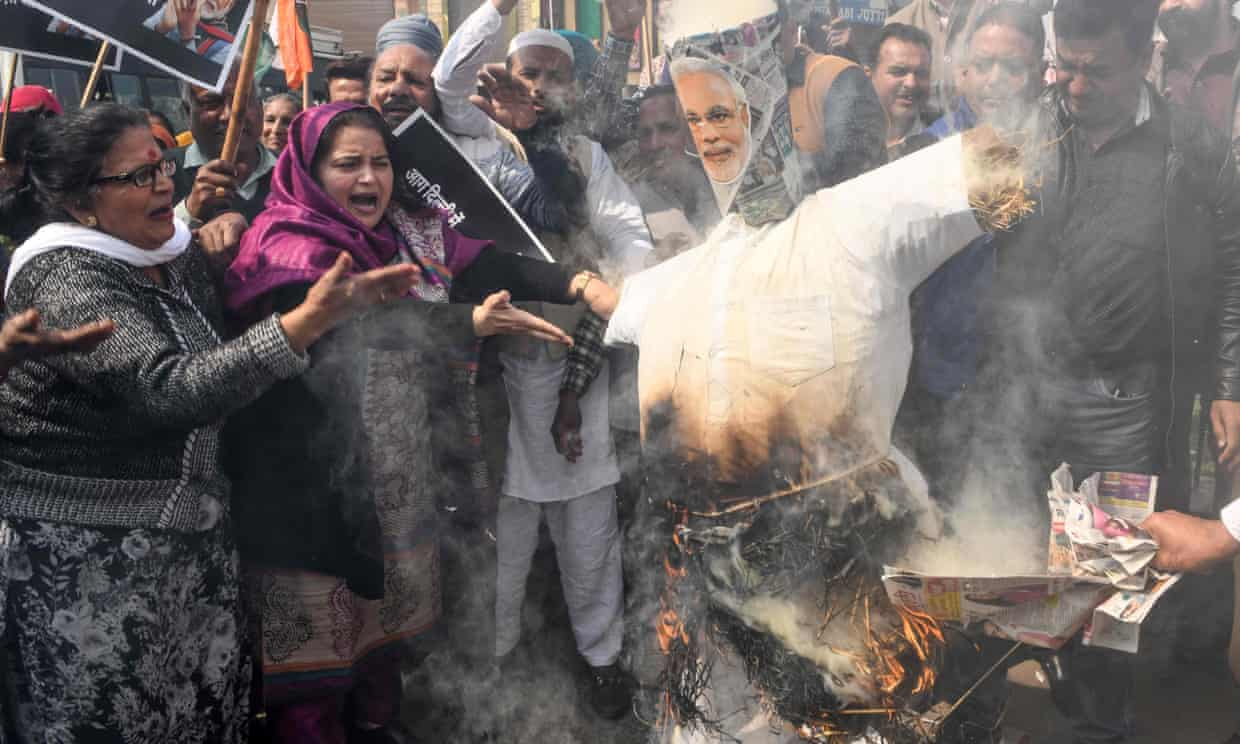 Congress party supporters in Amritsar burn an effigy of Narendra Modi during a demonstration to protest against the violence occurring in Delhi. Photograph: Narinder Nanu/AFP via Getty Images
