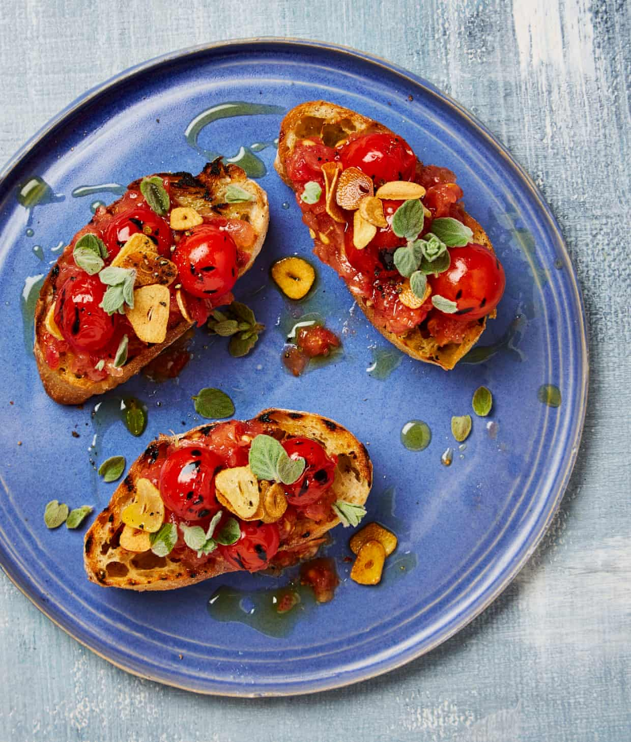 Yotam Ottolenghi's grilled bread with tomato and fried garlic.