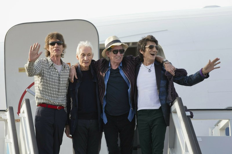 In this March 24, 2016 file photo, members of The Rolling Stones, from left, Mick Jagger, Charlie Watts, Keith Richards and Ron Wood pose for photos from their plane at Jose Marti international airport in Havana, Cuba. The Rolling Stones are threatening U.S. President Donald Trump with legal action for using their songs at his reelection campaign rallies despite cease-and-desist directives, according to a statement issued by the band Sunday June 28, 2020