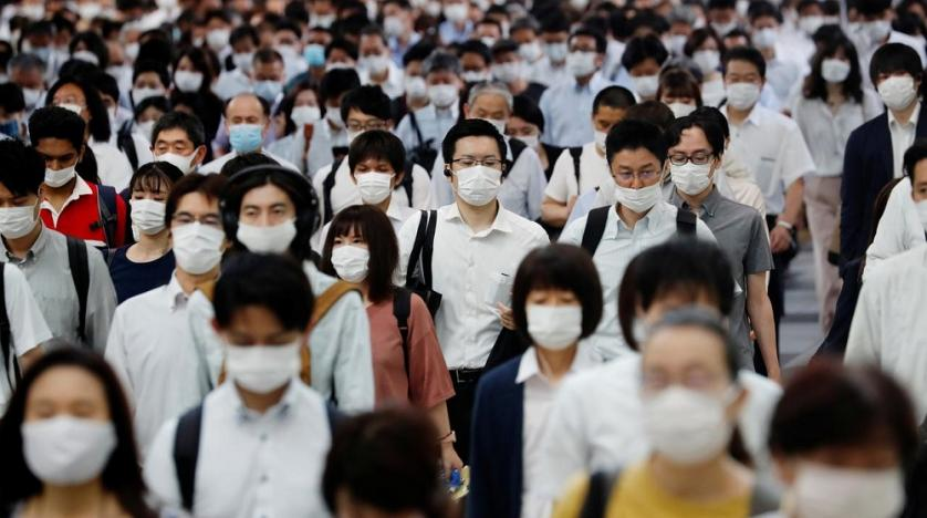 People wearing protective masks amid the coronavirus outbreak, make their way during rush hour at a railway station in Tokyo, Japan, July 3, 2020. (Reuters)