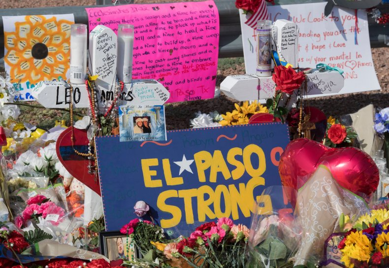 Signs and flowers adorn the makeshift memorial for victims of the shooting that left a total of 22 people dead at the Cielo Vista Mall Walmart, in El Paso, Texas, on August 7, 2019. On Thursday, the Global Terrorism Database released its annual report that showed racially and ethnically motivated terrorist attacks were on the rise in the U.S.