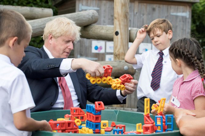 Britain's Prime Minister Boris Johnson plays with toys as students look on during a visit to The Discovery School in Kent, Britain. (File/Reuters)