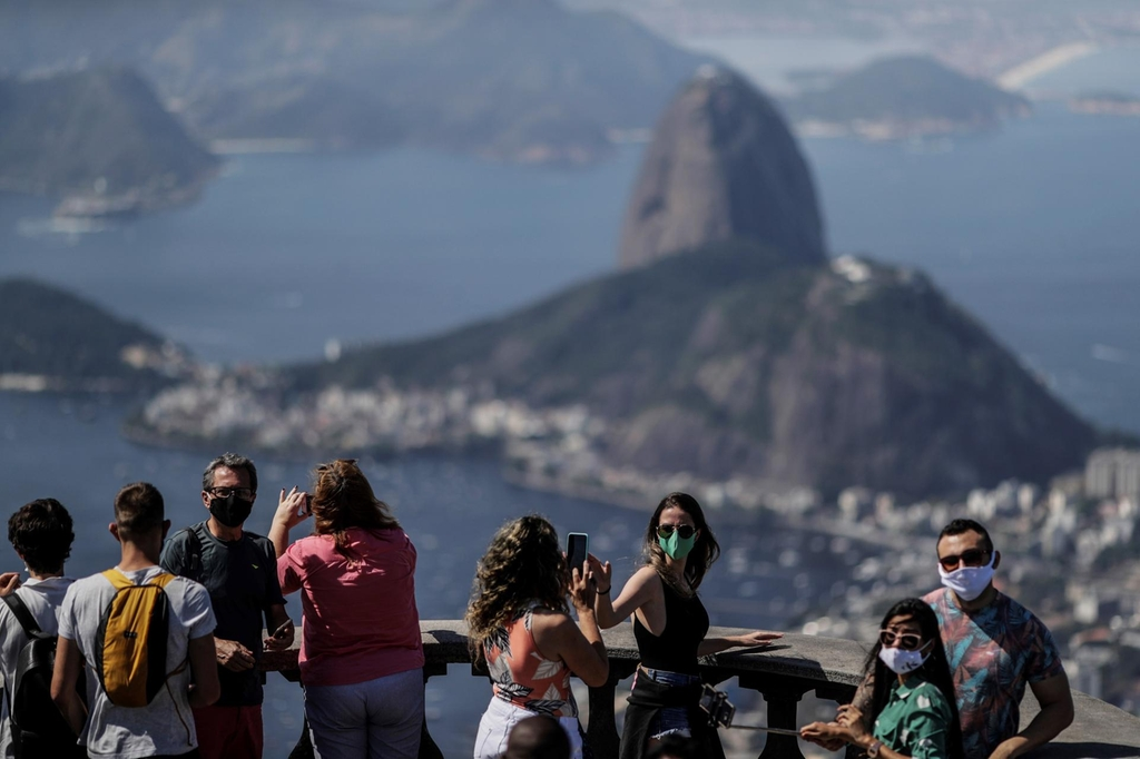 Rio de Janeiro has reopened touristic hot spots including Sugarloaf Mountain (pictured in background) and the Rio Star. EPA