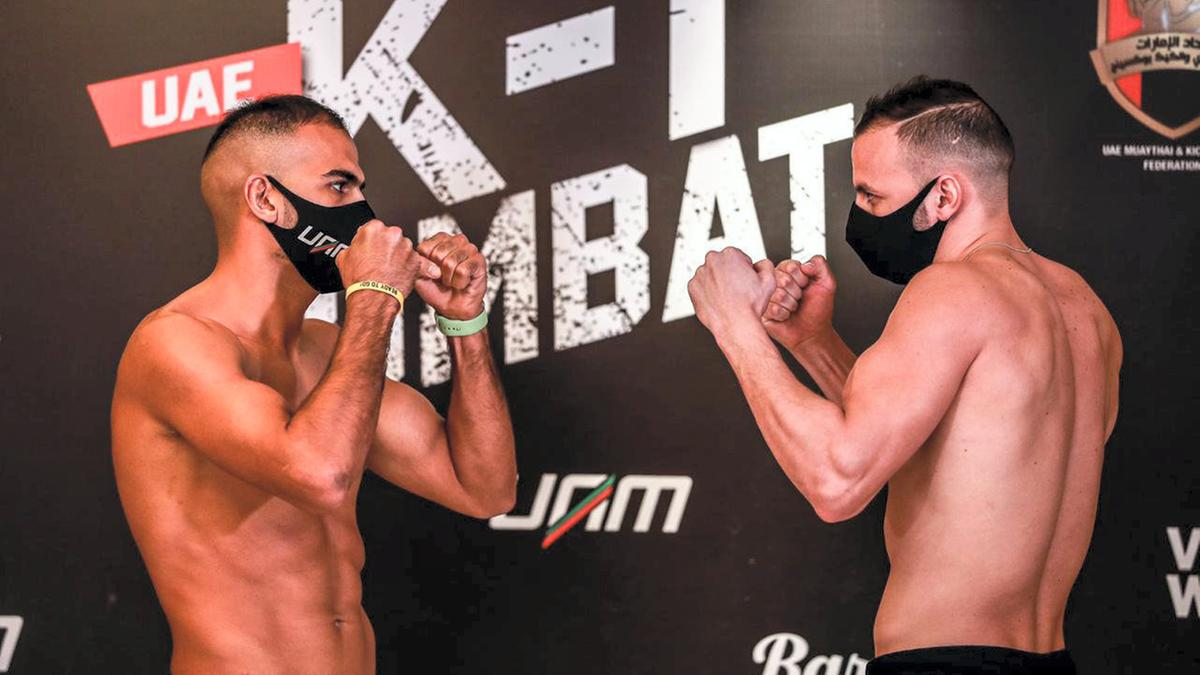 Ilyass Habibali, left, (L) and Haroun Baka face-off after the weigh-in ahead of the K-1 Combat in Dubai.